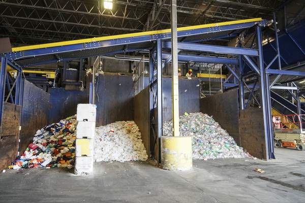 Mike Moore   The Journal Gazette  Plasticare sorted into three types by employeesat the Republic Services recycling facility on East Pontiac Street in Fort Wayne.