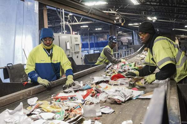 Mike Moore   The Journal Gazette  Employees of Republic Servicestake anything that is not recyclable off a conveyor beltat the company's East Pontiac Street facility inFort Wayne.