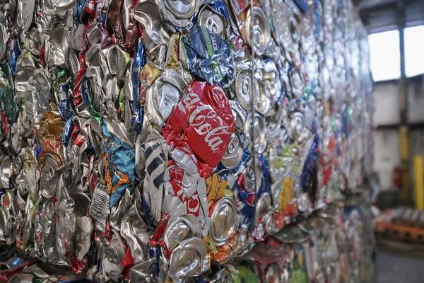 Aluminum cans are baled into cubes that weigh about 1,000 pounds each before being moved to a holding facility at Republic Services' recycling center on East Pontiac Street.