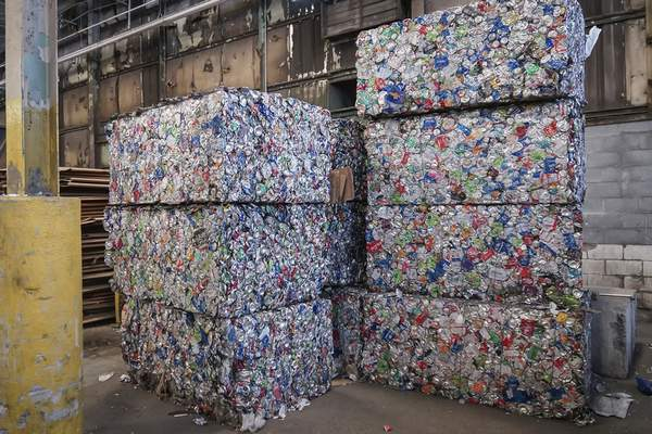 Mike Moore | The Journal Gazette  Aluminum can bales like thesecan weighup to 1,000 pounds before being moved to a holding facility at Republic Services' recycling center on East Pontiac Street.