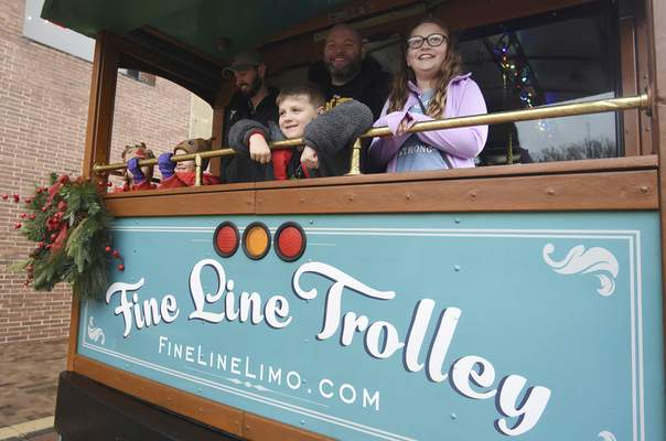 Photos by Rachel Von   The Journal Gazette The shopping trolleys were busy Saturday as, from left, 6-year-old twins Lilia and Giuliana Fritz and their father, Adam Fritz, took a ride along with Dave Horner, his daughter, Ella Horner, 11, and son, Gabe Horner, 7.