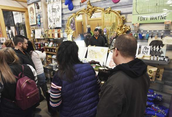 Rachel Von   The Journal Gazette  Guests enjoy shopping inside Valontine in the City Exchange Shops during the Holly Trolley Shopping event on Saturday.