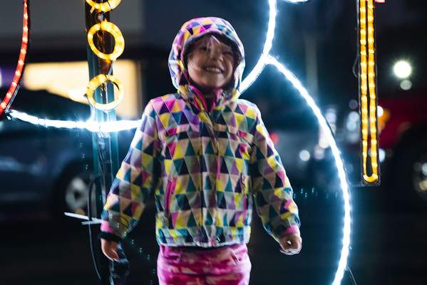 Gracelyn Hudson, 4, stands in front of one of the light displays Saturday night outside of Longe Optical.
