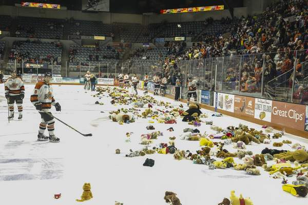File photo  Players begin to clean the ice after the Teddy Bear toss in 2015 at Memorial Coliseum.