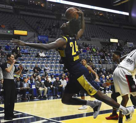 Rachel Von | The Journal Gazette  Mad Ants' Alize Johnson dives with the ball during the first half against Raptors 905 at the Coliseum on Thursday.