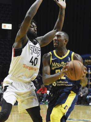 Rachel Von | The Journal Gazette  Mad Ants' Davon Reed pushes past Raptors 905's Chris Boucher to get to the hoop during the first half at the Coliseum on Thursday.