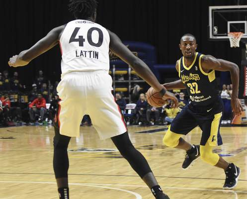 Rachel Von | The Journal Gazette  Mad Ants' Davon Reed looks for an opening past Raptors 905's Khadeem Lattin during the first half at the Coliseum on Thursday.