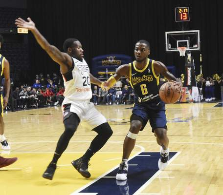 Rachel Von   The Journal Gazette  Mad Ants' Tra-deon Hollins pushes past Raptors 905's Kay Felder to get to the hoop during the first half at the Coliseum on Thursday.