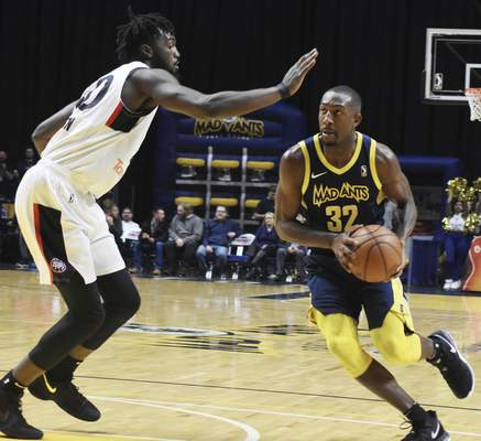 Rachel Von   The Journal Gazette  Mad Ants' Davon Reed looks for an opening past Raptors 905's Khadeem Lattin during the first half at the Coliseum on Thursday.