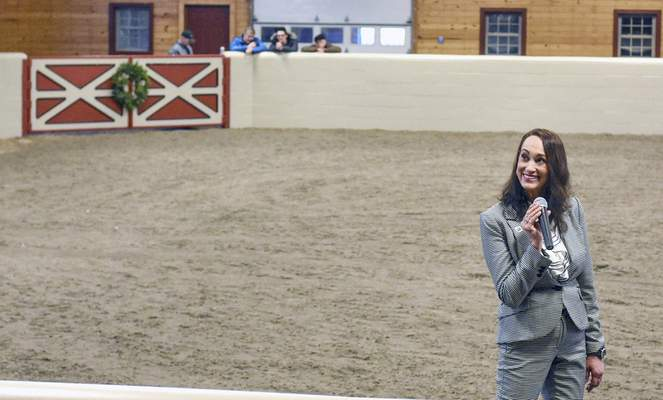 Lisa Anne Schrader, with Reecer Properties Inc., auctions the horse farm owned by Dick Freeland on Thursday.(Michelle Davies | The Journal Gazette)