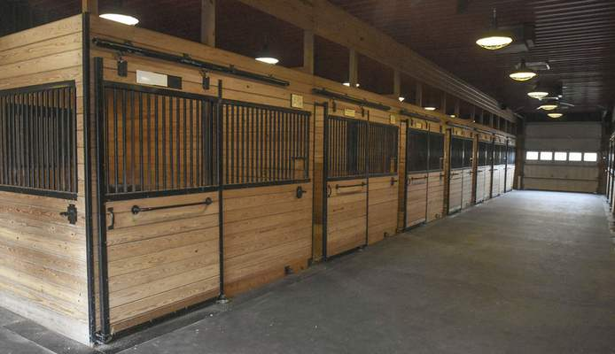 The barn had 47 stalls for horses and state-of-the-art breeding facilities.
