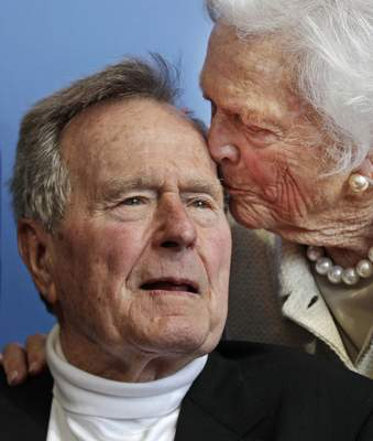 FILE - In this June 12, 2012 file photo, former President George H.W. Bush, and his wife, former first lady Barbara Bush, arrive for the premiere of HBO's new documentary on his life near the family compound in Kennebunkport, Maine. Bush has died at age 94. (AP Photo/Charles Krupa, File)