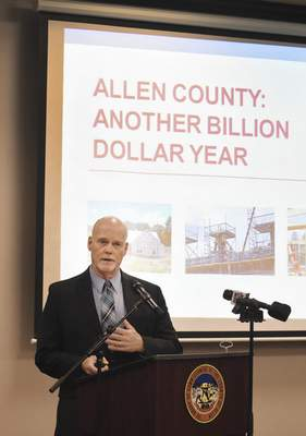 Allen County Commissioner Nelson Peters announces Tuesday that building permits topped $1 billion in 2018, reaching the mark days earlier than 2017. (Rachel Von | The Journal Gazette)