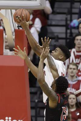 Indiana's Juwan Morgan (13) puts up a shot against Louisville's V.J. King (13) during the first half of an NCAA college basketball game, Saturday, Dec. 8, 2018, in Bloomington, Ind. (AP Photo/Darron Cummings)