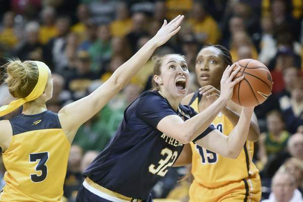 Notre Dame forward Jessica Shepard (32) drives to the basket between Toledo guard Mariella Santucci (3) and center Kaayla McIntyre (15) during the first half of an NCAA college basketball game Saturday, Dec. 8, 2018, in Toledo, Ohio. (AP Photo/David Richard)
