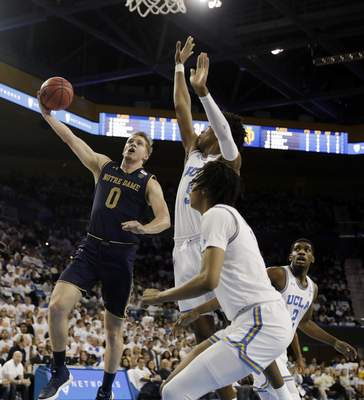 Notre Dame guard Rex Pflueger (0) drives to the basket during the first half of the team's NCAA college basketball game against UCLA on Saturday, Dec. 8, 2018, in Los Angeles. (AP Photo/Marcio Jose Sanchez)