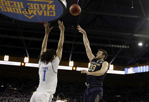 Notre Dame forward John Mooney (33) shoots over UCLA center Moses Brown (1) during the first half of an NCAA college basketball game Saturday, Dec. 8, 2018, in Los Angeles. (AP Photo/Marcio Jose Sanchez)