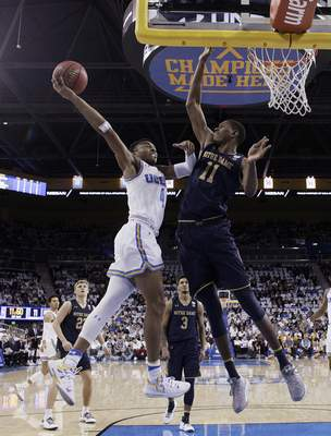 UCLA guard Jaylen Hands, left, drives to the basket as Notre Dame forward Juwan Durham (11) defends during the first half of an NCAA college basketball game Saturday, Dec. 8, 2018, in Los Angeles. (AP Photo/Marcio Jose Sanchez)