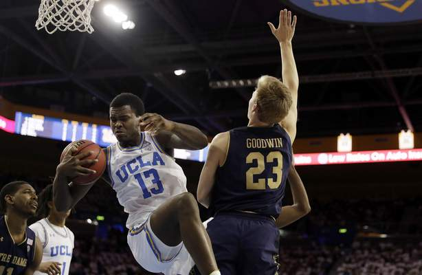 UCLA's Kris Wilkes (13) grabs a rebound next to Notre Dame's Dane Goodwin (23) during the first half of an NCAA college basketball game Saturday, Dec. 8, 2018, in Los Angeles. (AP Photo/Marcio Jose Sanchez)