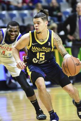 Mike Moore | The Journal Gazette  Westchester Knicks guard Kadeem Allen, left, tries to catch Mad Ants guard Rob Gray as he drives down the court in the second quarter at Memorial Coliseum on Thursday.