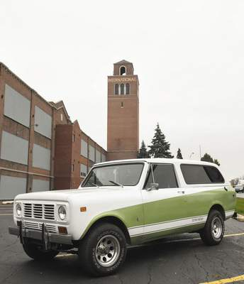 Michelle Davies | The Journal Gazette A 1976 Scout Traveler, owned by Ryan DuVall,sits in front of the tower and the old Harvester plant.