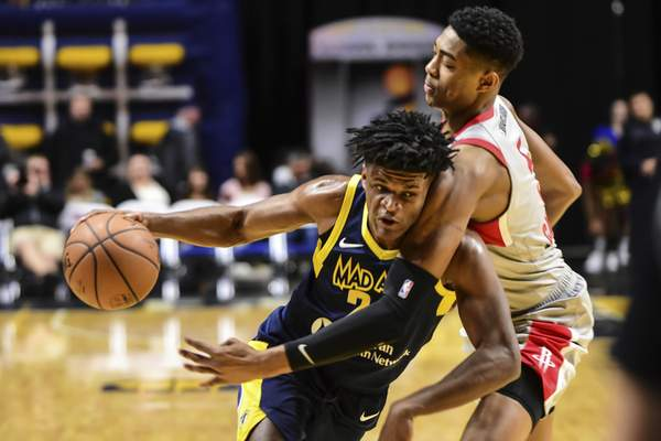 Mike Moore | The Journal Gazette Mad Ants forward Alize Johnson is fouled by Rio Grande Valley forward Bruno Caboclo while driving to the basket in the first quarter at Memorial Coliseum on Monday.