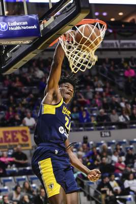 Mike Moore | The Journal Gazette Mad Ants forward Alize Johnson dunks the ball in the first quarter against Rio Grande Valley at Memorial Coliseum on Monday.