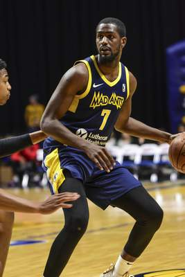 Mike Moore | The Journal Gazette Mad Ants forward Omari Johnson looks to pass the ball in the first quarter against Rio Grande Valley at Memorial Coliseum on Monday.