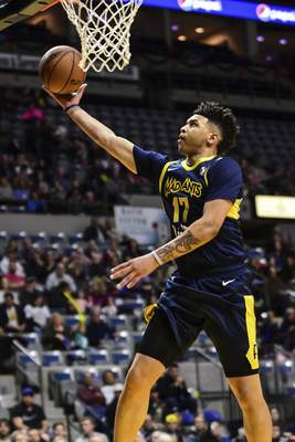 Mike Moore | The Journal Gazette Mad Ants guard Stephan Hicks scores under the basket in the second quarter against Rio Grande Valley at Memorial Coliseum on Monday.