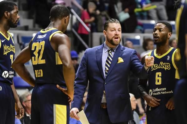 Mike Moore | The Journal Gazette Mad Ants head coach Steve Gansey speaks with his team along the sideline during a time out in the first quarter against Rio Grande Valley at Memorial Coliseum on Monday.