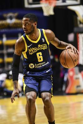Mike Moore | The Journal Gazette Mad Ants guard Tra-Deon Hollins looks to pass the ball in the first quarter against Rio Grande Valley at Memorial Coliseum on Monday.