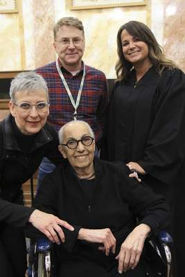 When retired educators Donna Roof, left, and Phyllis Bush decided to marry, they sought guidance about the logistics from former students Tim Manges, an attorney, and Judge Andrea Trevino. Trevino performed their Dec. 11 ceremony at the Allen County Courthouse. (Courtesy Kim Waldschmidt)