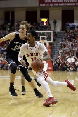 Indiana's Devonte Green (11) goes to the basket against Central Arkansas's Hayden Koval (15) during the second half of an NCAA college basketball game, Wednesday, Dec. 19, 2018, in Bloomington, Ind. Indiana won 86-53. (AP Photo/Darron Cummings)