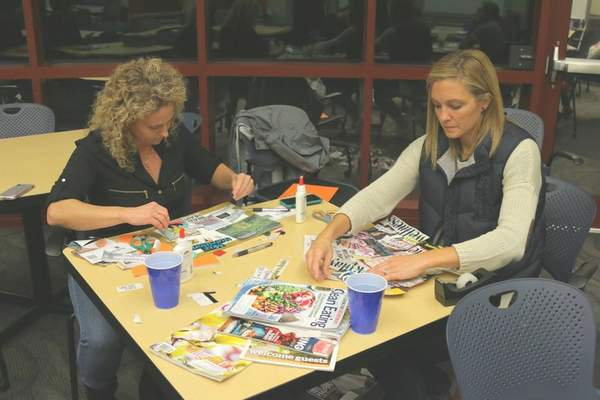 Courtesy Northeast Indiana Innovation Center  Kelley Marvin, left, and Amber Harper participate in theWEOC Launch Women Business Builder Workshop.