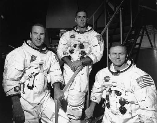 Associated Press Apollo 8 astronauts, from left, James Lovell, William Anders and Frank Borman were the first people to orbit the moon, snapping the iconic photo of Earth.