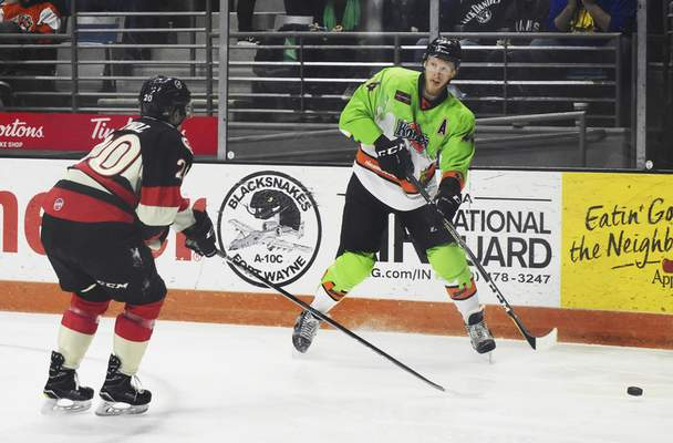 Rachel Von | The Journal Gazette  Komets' Cody Sol looks to shoot the puck past the Cyclones' Arvin Atwal during the second period at the Coliseum on Saturday.
