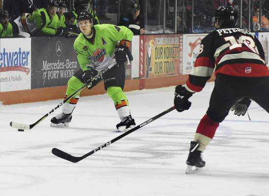 Rachel Von | The Journal Gazette  Komets' Jason Binkley tries to get past the Cyclones' Judd Peterson during the second period at the Coliseum on Saturday.
