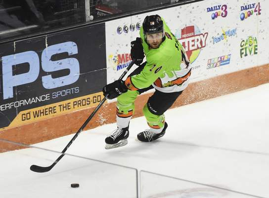 Rachel Von | The Journal Gazette  Komets' Brady Shaw moves the puck across the ice during the first period against the Cyclones at the Coliseum on Saturday.