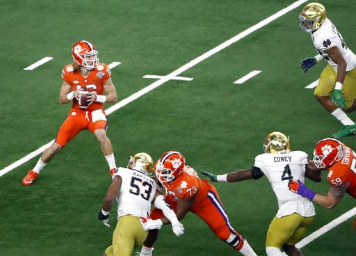 Clemson quarterback Trevor Lawrence (16) prepares to throw fro the pocket in the first half of the NCAA Cotton Bowl semi-final playoff football game against Notre Dame on Saturday, Dec. 29, 2018, in Arlington, Texas. (AP Photo/Roger Steinman)
