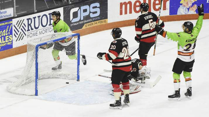 Rachel Von | The Journal Gazette  Komets players celebrate after scoring a goal during the first period against the Cyclones at the Coliseum on Saturday.