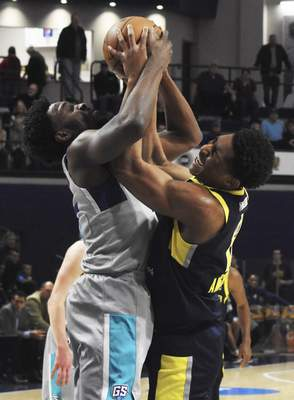 Rachel Von | The Journal Gazette  Mad Ants' Ike Anigbogu and Swarm's Chinanu Onuaku fight for the ball during the first quarter in the MTI Center at Trine on Sunday.