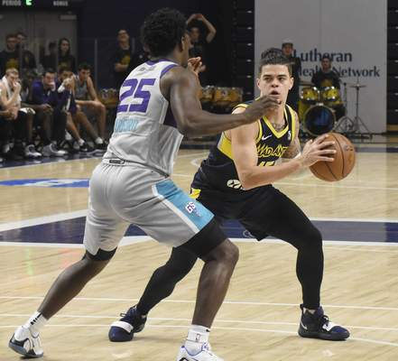 Rachel Von | The Journal Gazette  Mad Ants' Rob Gray looks for a teammate to pass the ball away from Swarm's Jaylen Barford during the second quarter in the MTI Center at Trine on Sunday.
