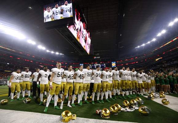 Associated Press Notre Dame players stand in the end zone singing in the direction of their fans after their 30-3 loss to Clemson in the Cotton Bowlon Saturday. The Irish finished 12-1 and have another long off-season ahead.