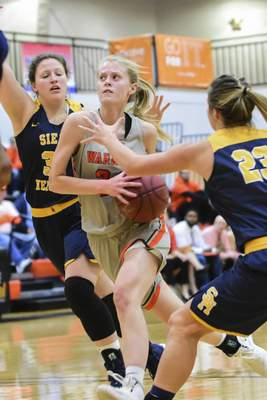 Mike Moore | The Journal Gazette Indiana Tech forward Kendall Knapke drives to the basket in the first quarter against Siena Heights at the Schaefer Center on Wednesday.
