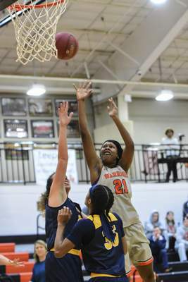 Mike Moore | The Journal Gazette Indiana Tech forward Isis Parker scores over Siena Heights defenders while driving to the basket in the second quarter at the Schaefer Center on Wednesday.