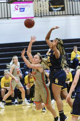 Mike Moore | The Journal Gazette Indiana Tech guard Rachel Bell scores under the basket in the first quarter against Siena Heights at the Schaefer Center on Wednesday.