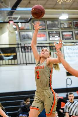 Mike Moore | The Journal Gazette Indiana Tech guard Rachel Bell scores under the basket in the second quarter against Siena Heights at the Schaefer Center on Wednesday.