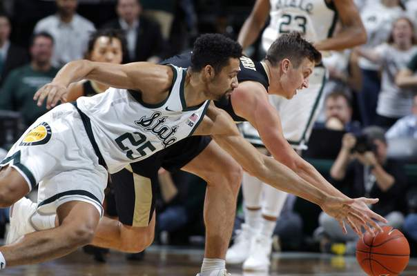 Purdue's Grady Eifert, a former Bishop Dwenger forward, dives for a loose ball during Purdue's 77-59 loss to No. 6 Michigan State on Tuesday in East Lansing. Eifert had six points and six rebounds in the game. (AP Photo/Al Goldis)