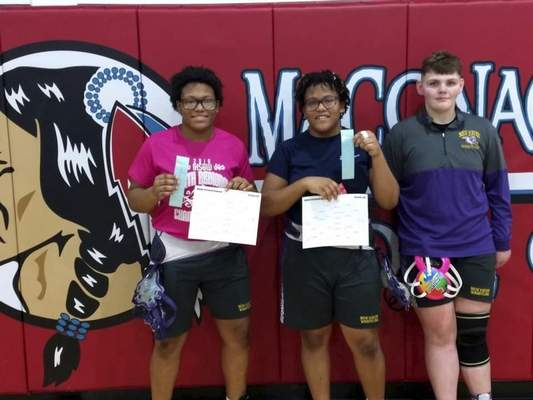 Courtesy New Haven wrestlers, from left, La'Rissa Bryant-Coleman and Larresha Bryant-Coleman won titles at theMaconaquah Regional on Jan. 4, and Alexandria Martz finished fifth.