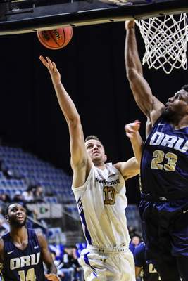 Mike Moore | The Journal Gazette Purdue Fort Wayne forward Matt Holba takes a shot at the basket in the first half against Oral Roberts at Memorial Coliseum on Thursday.